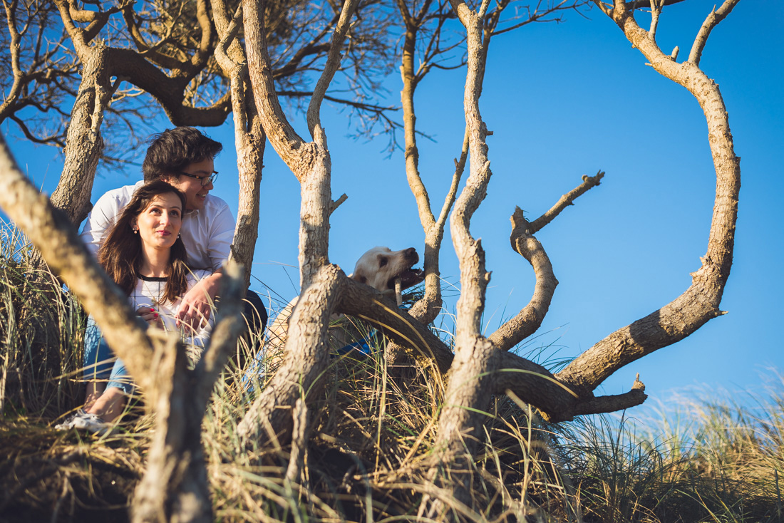 portrait of couple and dog at muriwai, auckland, new zealand